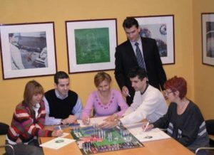 Managers playing a business simulation game.